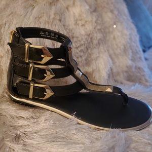 Black and Gold Gladiator Sandal- Fergie